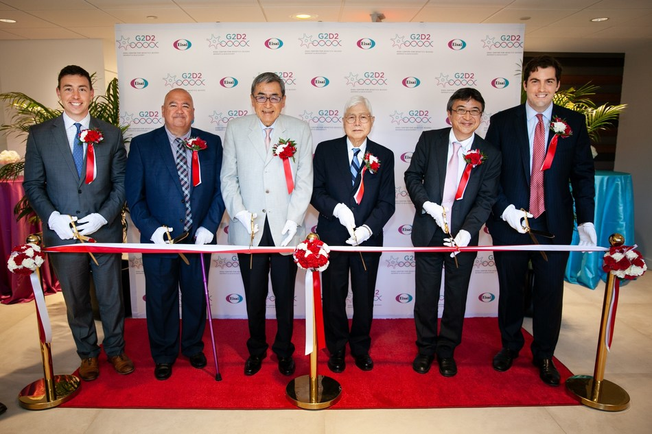 """On July 9, Eisai officially announced the grand opening of its new Center for Genetics Guided Dementia Discovery (""""G2D2"""").  Integrating its cutting-edge strengths in human genetics, data sciences and precision chemistry, the 50,000 square foot research facility will focus on immunotherapy for dementia.  (Standing from left to right) Ryan Fattman, U.S. Senator for Massachusetts; Mike Belleville, patient living with dementia; Haruo Naito, Eisai CEO;  Yoshito Kishi, Morris Loeb Professor of Chemistry, Harvard University;  Yasushi Nakamura, Acting Consul General at Consulate General of Japan in Boston; Mark Fuller, Undersecretary for Business Growth, Executive Office of Economic Development."""