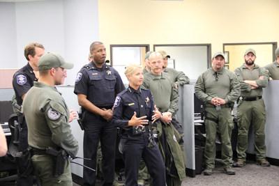 Aurora Police Chief Kristen Ziman and officers