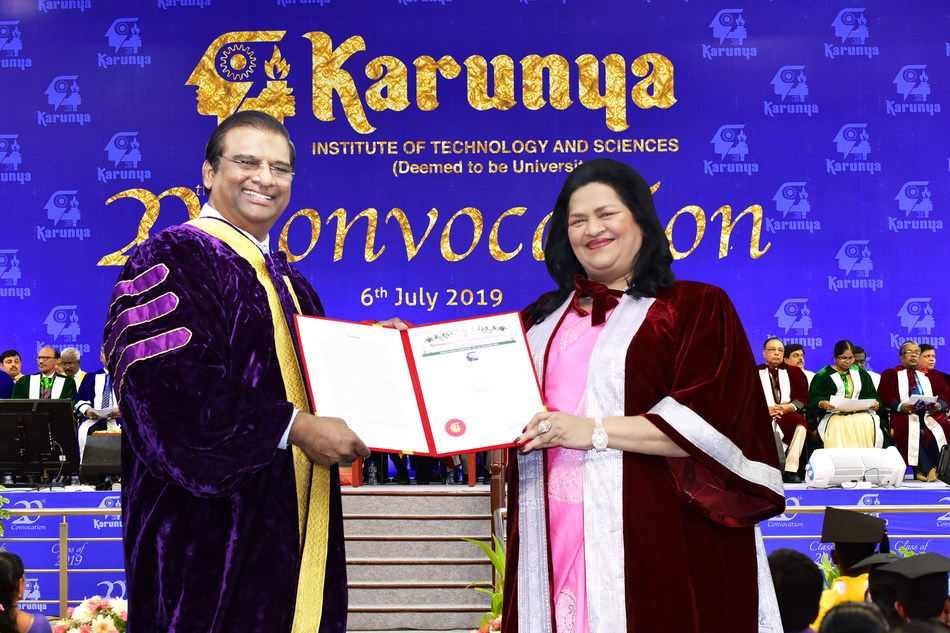 Dr. Paul Dhinakaran,the Chancellor Karunya University presenting the doctorate degree to Madam Grace Pinto