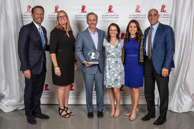 Varsity Brands accepts Spirit of St. Jude Award.