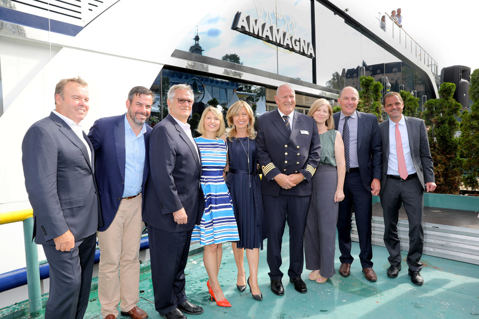 Special guests and partners join co-founders Rudi Schreiner and Kristin Karst as Godmother Samantha Brown (fourth from left) christens AmaMagna