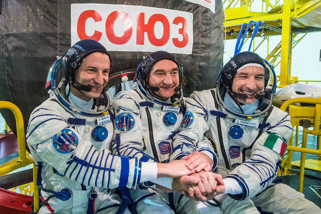 At the Baikonur Cosmodrome in Kazakhstan, Expedition 60 crew members Drew Morgan of NASA, Alexander Skvortsov of the Russian space agency Roscosmos and Luca Parmitano of ESA (European Space Agency) pose for pictures July 5, 2019, in front of their Soyuz MS-13 spacecraft during prelaunch preparations. They will launch July 20, 2019 from the Baikonur Cosmodrome in Kazakhstan for their mission on the International Space Station. Credits: Roscosmos/Andrey Shelepin