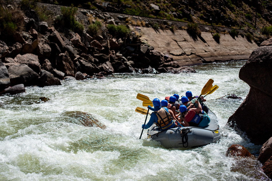 A member of the Arkansas River Outfitters Association (AROA) navigates Sunshine Rapid in the Royal Gorge of the Arkansas River.