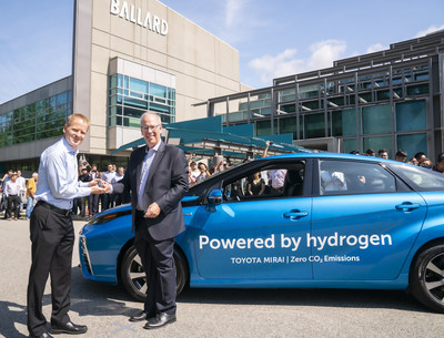 Stephen Beatty, (right) Vice President, Corporate, Toyota Canada Inc. provides Randy MacEwen, (left) President and CEO of Ballard Power Systems with the keys to a new fuel cell Toyota Mirai. (CNW Group/Ballard Power Systems Inc.)