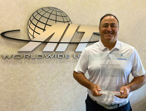 AIT Worldwide Logistics' President and CEO, Vaughn Moore, with the American Cancer Society's Chicago Select Corporate Partnership Award
