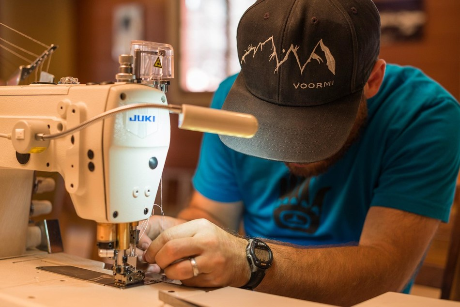 A worker sewing at apparel manufacturer VOORMI in Pagosa Springs, Colo., one of the projects featured in the 2019 NMTC Progress Report