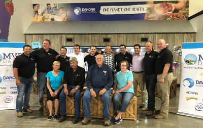 McCarty and VanTilburg families with Danone North America leaders celebrate the opening of MVP Dairy in Celina, OH.