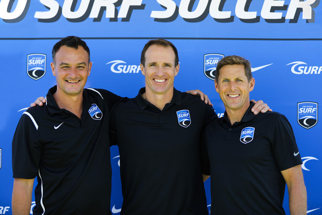 Drew Brees pictured with Surf Sport's National Sporting Director, Josh Henderson and CEO Brian Enge