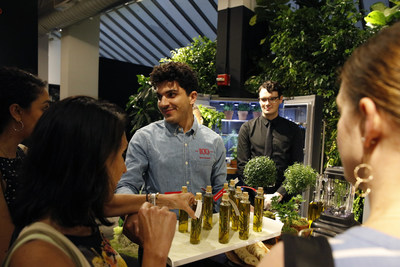 Guests transform fresh herbs and spices into compound butter and infused oils in New York City, Thursday, July 18, 2019. (Clarence Sormin)
