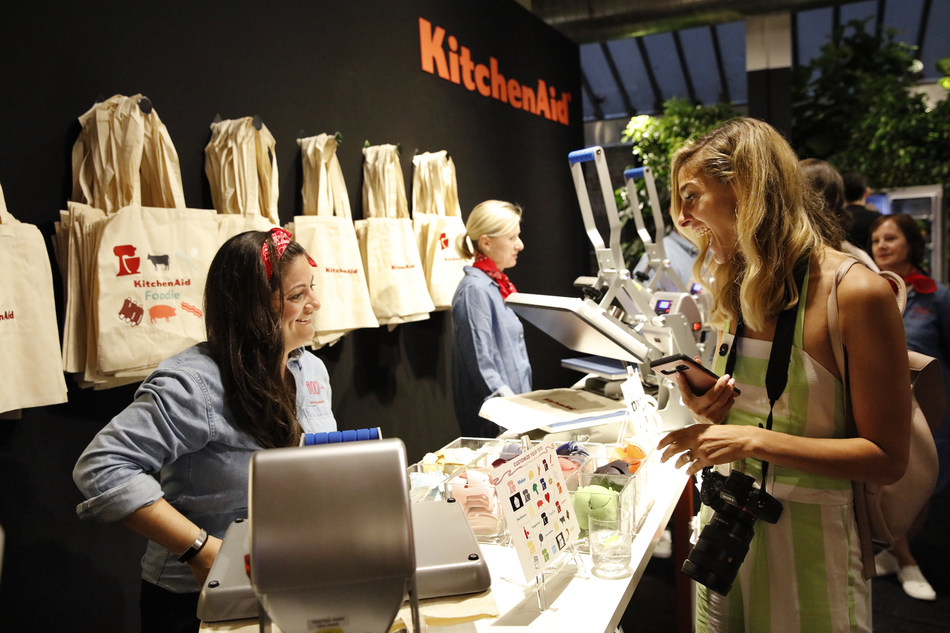 Guests decorate tote bags with unique patches that represent who they are in the kitchen from the KitchenAid Culinary Playground in New York City, Thursday, July 18, 2019. (Clarence Sormin)