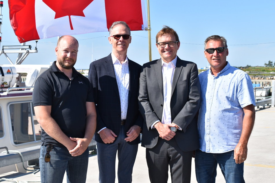 From left to right: Martin Mallet, Executive Director of the Maritime Fishermen's Union, Pat Finnigan, Member of Parliament for Miramichi — Grand Lake, the Honourable Jonathan Wilkinson, Minister of Fisheries, Oceans and the Canadian Coast Guard, and Ernest Mazerolle, President of the Pointe-Sapin Port Authority at a Small Craft Harbour announcement in Pointe-Sapin, New Brunswick. (CNW Group/Fisheries and Oceans (DFO) Canada)