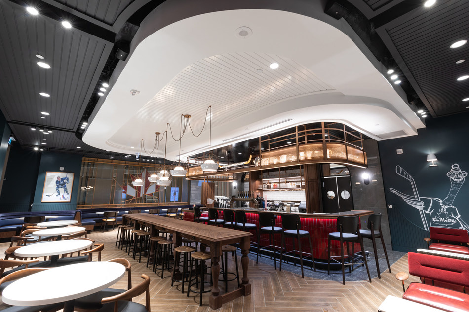 The design is inspired by Tim Horton himself with hockey cues tying back to the brand's roots found throughout the space. (CNW Group/Tim Hortons)
