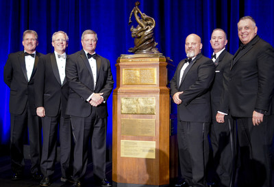 DCS employee-owners pose with the Collier Trophy. Mark Wilkins (third from left) and Finley Barfield (not pictured) are key members of the winning AGCAS Team.