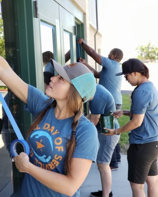 Chantae Hoskins works alongside other MarketStar employees as they prep and paint the recreation center in Ogden, UT during MarketStar's 4th annual Global Day of Service.