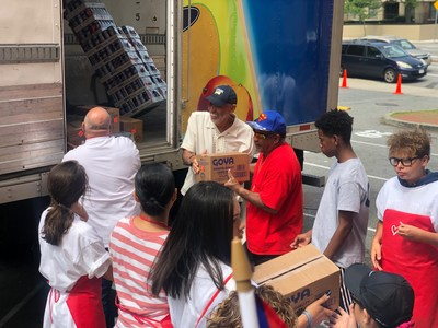 Goya and volunteers from the Puerto Rican Festival help to unload 2,500 pounds of food from the Goya truck to help feed the hungry in Massachusetts.