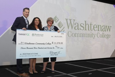 Laura Crane from Washtenaw Community College accepts the Power of X grant at the 2019 TargetX Summit