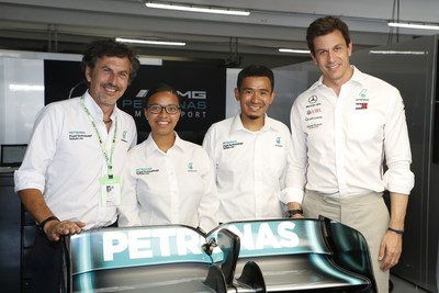 Giuseppe D?Arrigo, Managing Director and CEO, PETRONAS Lubricants International, Stephanie Travers and Nasri Shafie, PETRONAS Trackside Fluid Engineers and Toto Wolff, Team Principal and CEO, Mercedes-AMG PETRONAS Motorsport in the team garage.