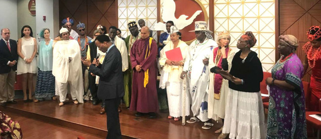 A prayer for peace at the Nelson Mandela Day interfaith forum at the Church of Scientology Harlem Community Center.