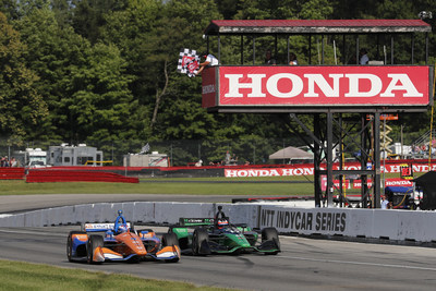 Scott Dixon, #9 Honda foreground, leads his teammate Felix Rosenqvist to the checker flags to take a narrow victory Sunday at the Honda Indy 200 NTT IndyCar Series race at the Mid-Ohio Sports Car Course.