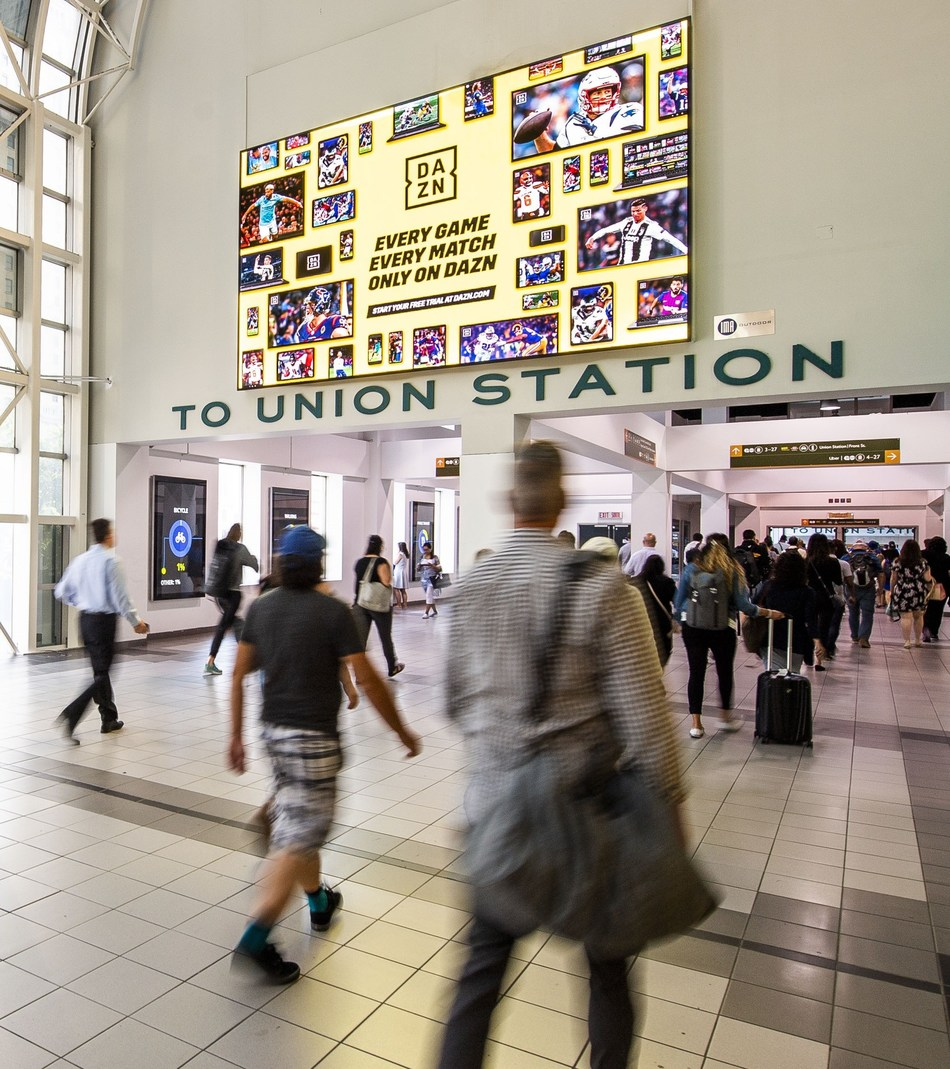 Sports streaming platform DAZN kicks off its 'The New Home of Football' campaign in Canada ahead of the 2019-2020 season with a takeover of Toronto's Union Station, featuring hundreds of unique pieces of static and digital creative highlighting how fans can stream every game and every match all season long – no matter which football they favour most – from the National Football League (NFL) to Premier League, UEFA Champions League and UEFA Europa League. (CNW Group/DAZN)