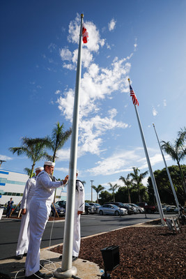 U.S. Navy Fleet Ballistic Program representatives raise Florida's flag at a new headquarters shared with Lockheed Martin in Titusville, Florida.