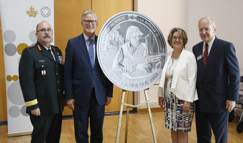 The unveiling of the fine silver coin commemorating the 75th anniversary of the Battle of the Scheldt (Ottawa, July 31, 2019).  From left: Major-General Stephen Whalen, Kingdom of the Netherlands Ambassador Henk van der Zwan, Royal Canadian Mint CEO Marie Lemay and Perley and Rideau Veterans' Health Centre Foundation Chair Keith de Bellefeuille Percy (CNW Group/Royal Canadian Mint)