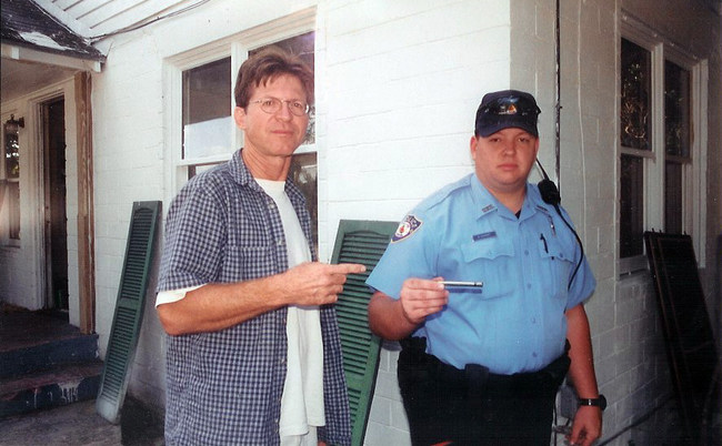 """Michael E. Arth, turning over crack pipe to police while rebuilding """"Cracktown"""""""