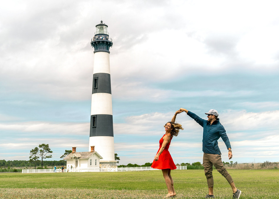 The savings available on an Outer Banks getaway this time of year will have you dancing! Try climbing the Bodie Island Lighthouse, one of three you can ascend on the OBX this summer! courtesy OuterBanks.org