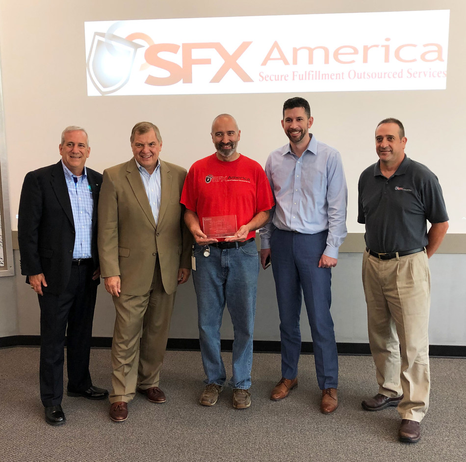 Canon Solutions America President, Peter Kowalczuk, (2nd from left) presented SFX America with a plaque to commemorate the milestone of the 5000th imagePRESS installation. Also in photo L to R: Mark Gill, Sr. Director Regional Sales, Canon Solutions America; from SFX America - Earl Grant, Production Manager, John Stevens, COO, and Shawn Humphrey, General Manager.