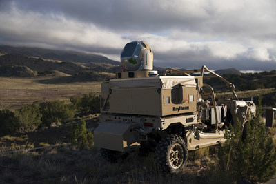 Raytheon's mobile high energy laser looks out into a wide-open sky. The company's advanced high power microwave and high energy laser engaged and defeated dozens of unmanned aerial system targets in a recent U.S. Air Force demonstration. (PRNewsfoto/Raytheon Company)