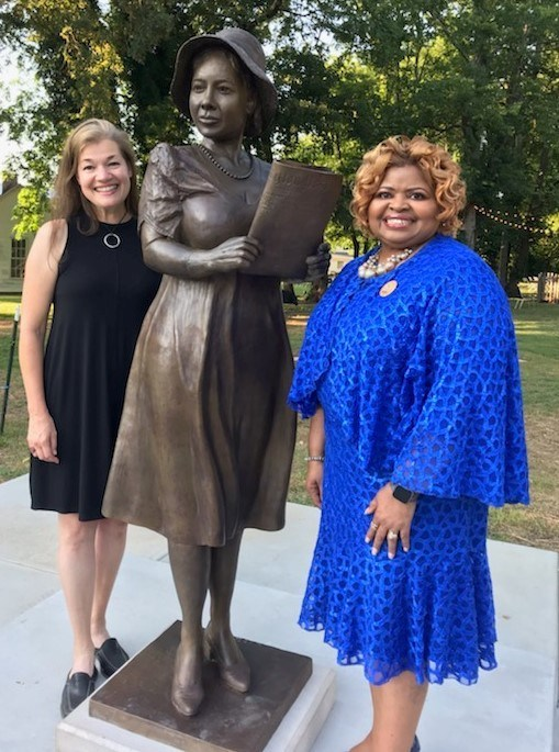 Sculptor Amanda Matthews, left, and Deborah Catchings-Smith, international president of Sigma Gamma Rho Sorority, pose with the bronze statue of Alice Allison Dunnigan, the first woman to receive press credentials to cover the White House in 1947, Thursday, August 1, 2019. The statue is now permanently installed in her hometown of Russellville, Kentucky on the grounds of the Seek Museum.