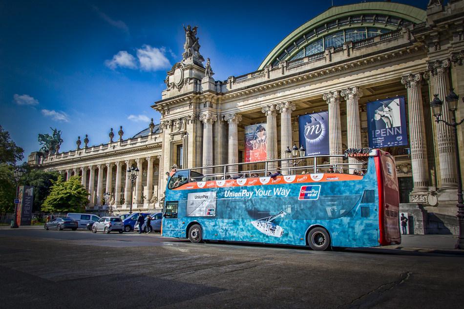 UnionPay-themed tour bus in Paris.