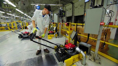 A Honda Power Equipment associate performs a quality check on a Honda lawnmower at the Swepsonville, NC plant (PRNewsfoto/Honda North America)
