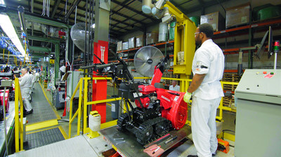 A Honda Power Equipment associate performs a quality check on a Honda snow thrower at the Swepsonville, NC plant (PRNewsfoto/Honda North America)