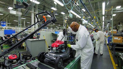 A Honda Power Equipment associate makes adjustments to a lawnmower in final assembly at the Swepsonville, NC plant (PRNewsfoto/Honda North America)