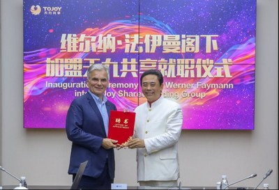 Mr. Lu Junqing, Chairman of the Board of ToJoy Group, presents the appointment letter for Mr. Werner Faymann