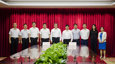 Guangzhou's Vice Mayor Chen Zhiyingand (5th from left), and EHang's founder, chairman, CEO, Mr. Hu Huazhi (5th from right). (PRNewsfoto/EHang Holdings Limited)