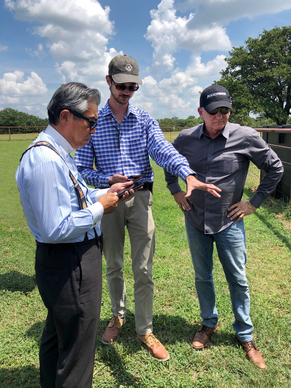 David Schroeder and Ron Hicks from HerdX show Ambassador Sugiyama how the HerdX animal monitoring app works.