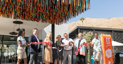 Earlier today, Palm Springs city council members, local dignitaries and fans gathered to watch as Taco Bell's Senior Director of Retail Engagement and Experience, Jennifer Arnoldt cut a ceremonial ribbon made of hot sauce packets, officially unveiling The Bell