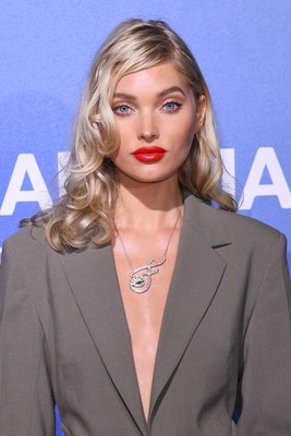 Credit: Anthony Harvey/Shutterstock - Elsa Hosk in vintage Versace, paired with a unique TABAYER Fearless Pendant, which is 18 karat white gold, adorned with an emerald and nearly 4 carats of VS+ diamonds; priced at $120,000.
