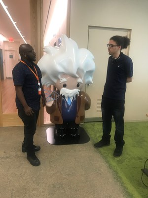 Kristian Goris speaks with Alfonso Eustache, a Salesforce colleague.