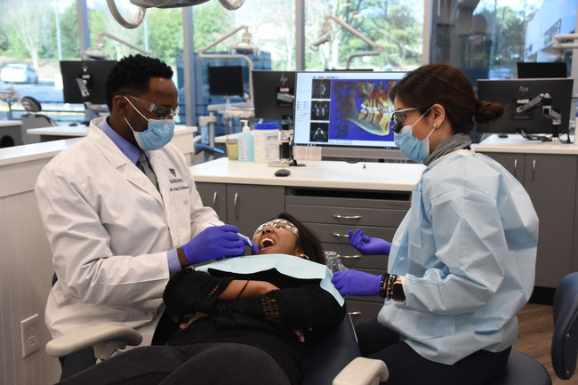 """Georgia School of Orthodontics has been granted """"Accreditation without Reporting Requirements"""" from the Commission on Dental Accreditation. L to R: Dr. Keith Williams, Rachel Sivaperagas, and Dr. Gabriela Herrera."""