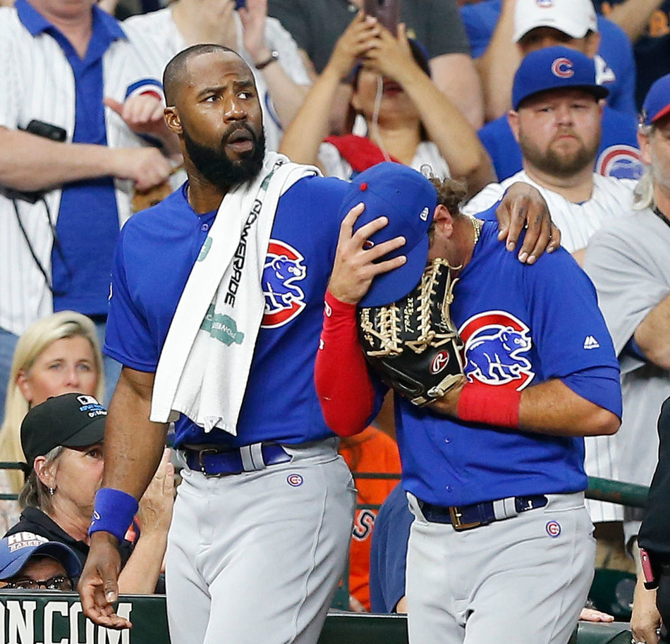 Albert Almora Jr. of the Chicago Cubs is comforted by Jason Heyward after checking on the young child that was injured by a hard foul ball off his bat in the fourth inning against the Houston Astros at Minute Maid Park on May 29, 2019 in Houston, Texas. Almora Jr. would leave the game. (Photo by Bob Levey/Getty Images)