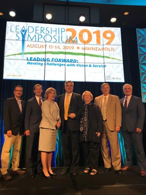 Conduent received the 2019 Corporate Associate of the Year Award from the National Child Support Enforcement Association at the organization's annual Leadership Symposium in Minneapolis. Accepting the award, from left to right, were Alex Camacho, Marcus Collier, Kim Newsom Bridges, Scott Cade, Robbie Endris, Hal Carl and Zach Steed.