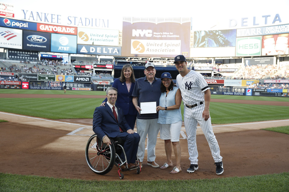 Left to right: Victor Calise, Commissioner, Mayor's Office for People with Disabilities; Kleo King, Deputy Commissioner & General Counsel, Mayor's Office for People with Disabilities; James Weisman, president & CEO, United Spinal Association; Holly Weisman; and Mike Tauchman, New York Yankees outfielder (PHOTO CREDIT: NEW YORK YANKEES. ALL RIGHTS RESERVED. © NEW YORK YANKEES)