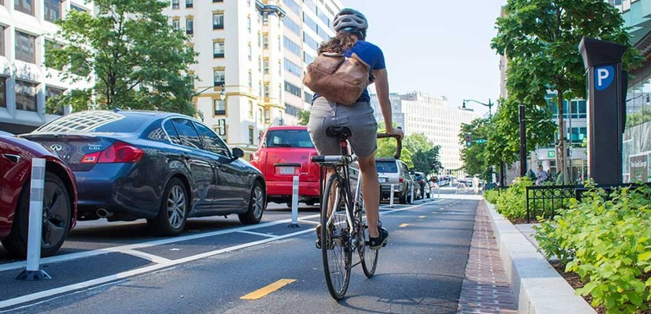 Street-level protected bike lanes like this one in Washington, D.C.,  have a high risk of injury to cyclists, a new IIHS study found.