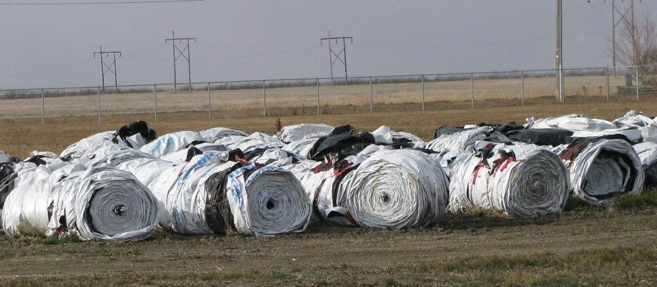 Rolled grain bags at a Saskatchewan Cleanfarms collection site ready to go to an end market to be washed, shredded and pelletized, and then recycled into new plastic bags. (CNW Group/CleanFARMS Inc.)