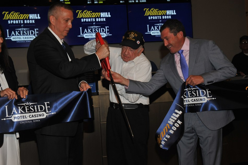 Included in photo: DAVE MONROE, VP & General Manager, Lakeside Hotel & Casino, JOSEPH REYNOLDS, Clark County Resident, WWII Veteran, DAVID GROLMAN, President of U.S. Retail Operations, William Hill