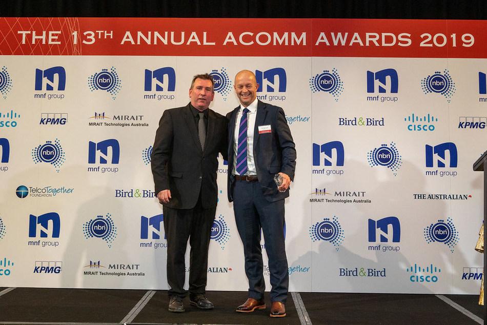 Hamish Lee, VP Sales APAC, Speedcast, receiving the ACOMM award
