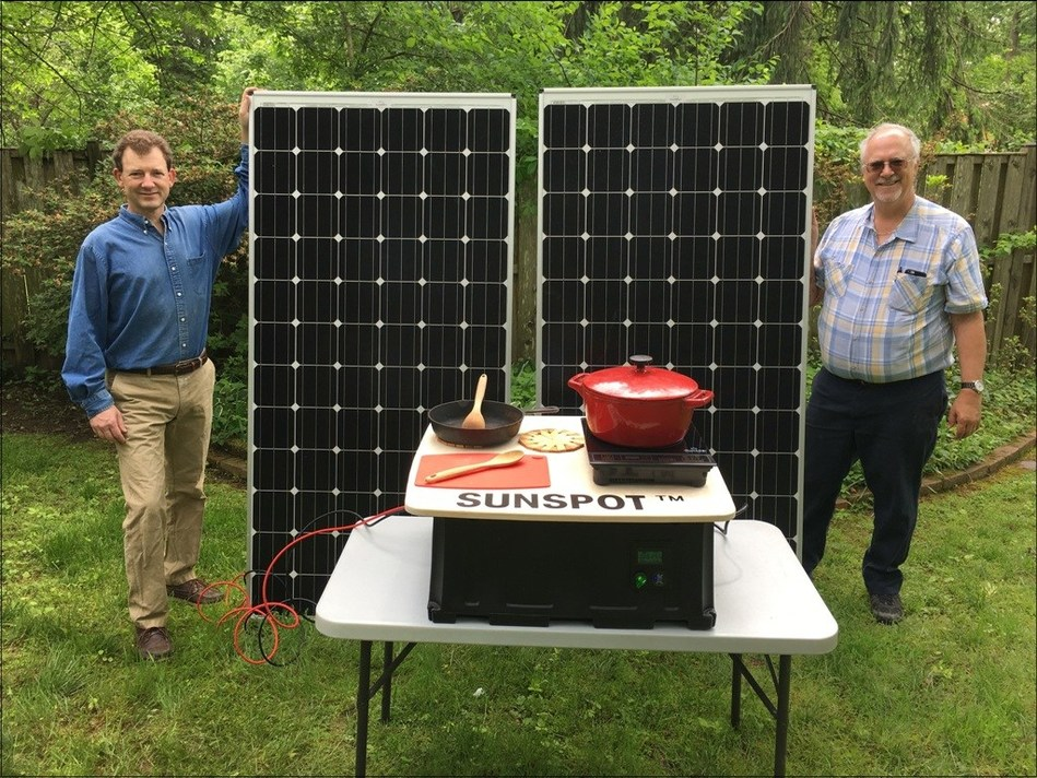 Paul Carroll and Douglas Danley (right) stand alongside the Sunspot Solar Electric Cooker. Danley, Carroll and team members Teresa Danley, and Vladimir Brunstein (not pictured) were this year's winners of the Elsevier-ISES Renewable Transformation Challenge (Credit: Douglas Danley).